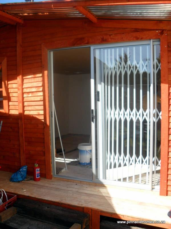 Wendy house with stoep, patio doors, and slam lock gate