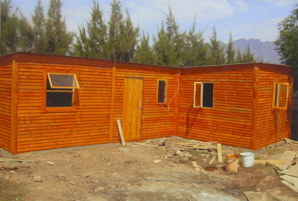 large l-shaped Wendy house in tradional overlap cladding
