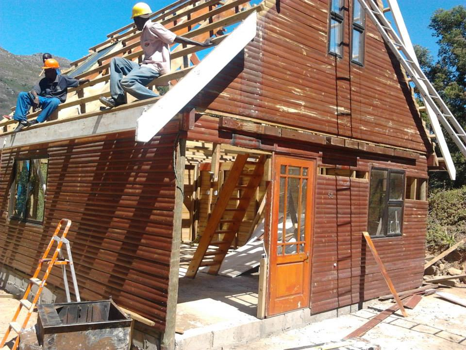 Constructing a log cabin style wooden house