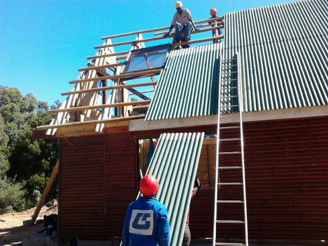 Zinc sheeting going on a wooden house